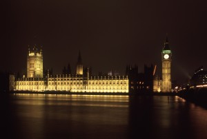 Houses of Parliament and Big Ben, London, illuminated at night and reflected in the water of the River Thames below